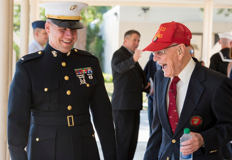 A U.S. Marine laughs with a World War II Marine Corps veteran before the 75th D-Day Commemoration at MacDill Air Force Base, Fla., June 6, 2019.