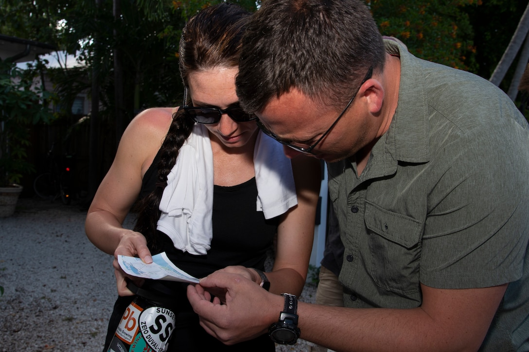 Capt. Amber Hauer, a 34th Aeromedical Squadron flight nurse, and Tech. Sgt. Nolan Beihl, a 34th AES medical technician, examine a map during the urban survival training portion of a three-day Survival Evasion Resistance and Escape refresher training in Key West, Florida, May 23, 2019. (U.S. Air Force photo by Tech. Sgt. Frank Casciotta)