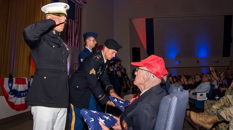 MacDill's joint service members present a flag during the 75th D-Day Commemoration to each World War II veteran in attendance at MacDill Air Force Base, Fla., June 6, 2019.