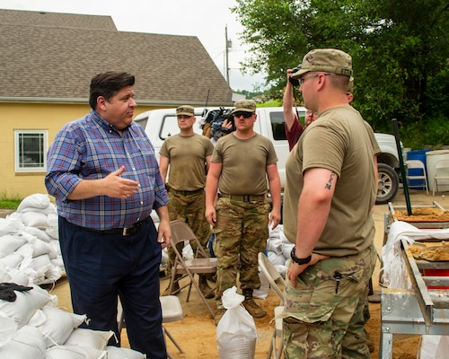 Illinois Gov. J.B. Pritzker talks with Soldiers of Battery B, 2nd Battalion, 123rd Field Artillery during a tour of flooding around Grafton, Illinois