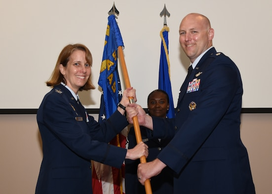 Lt. Col. Matthew Sikkink assumed command of the 815th Airlift Squadron from Col. Jennie R. Johnson, 403rd Wing commander, during change of command ceremony June 6, 2019. (U.S. Air Force photo by Master Sgt. Jessica Kendziorek)