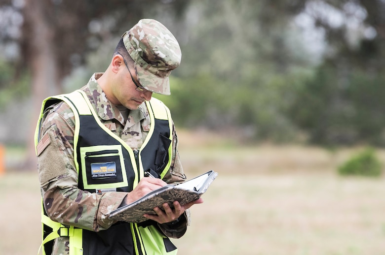 Staff Sgt. Diego Bermudez, 30th Space Wing Inspector General team member and judge advocate NCO in charge of military justice, takes notes during an earthquake exercise June 5, 2019, at Vandenberg Air Force Base, Calif. During exercises, 30th IG inspection teams ensure units follow proper protocol, as well as provide feedback to the commander on how processes can be improved. (U.S. Air Force photo by Airman 1st Class Hanah Abercrombie)