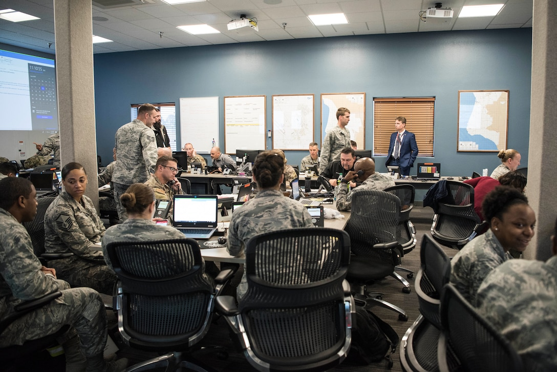 30th Space Wing members in the Emergency Operations Center work together during an earthquake exercise June 5, 2019, at Vandenberg Air Force Base, Calif. Exercises are performed throughout each year to test the base's readiness and ability to respond to mission crisis, natural disaster and other urgent situations. (U.S. Air Force photo by Airman 1st Class Hanah Abercrombie)