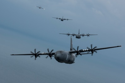 Three C-130J Super Hercules, belonging to the 37th Airlift Squadron on Ramstein Air Base, fly in a four-ship formation with a C-17 Globemaster III trailing a mile behind over the Atlantic Ocean near Normandy, France, June 5, 2019. The 37th AS is a legacy squadron to the 37th Troop Carrier Squadron, who on D-Day, June 6, 1944, accurately dropped hundreds of paratroopers onto the intended drop zone. The objective: to seize the city of Sainte-Mère-Église. The precision and accuracy carried out by the 37th TCS allowed the paratroopers to quickly take the city. Later, it would be discovered Sainte-Mère-Église was the first city liberated in France by Allied forces, in part because of the effort provided by the 37th TCS. (U.S. Air Force photo by Senior Airman Kristof J. Rixmann)