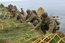 75th Ranger Regiment reenacts the climb at Pointe Du Hoc, France