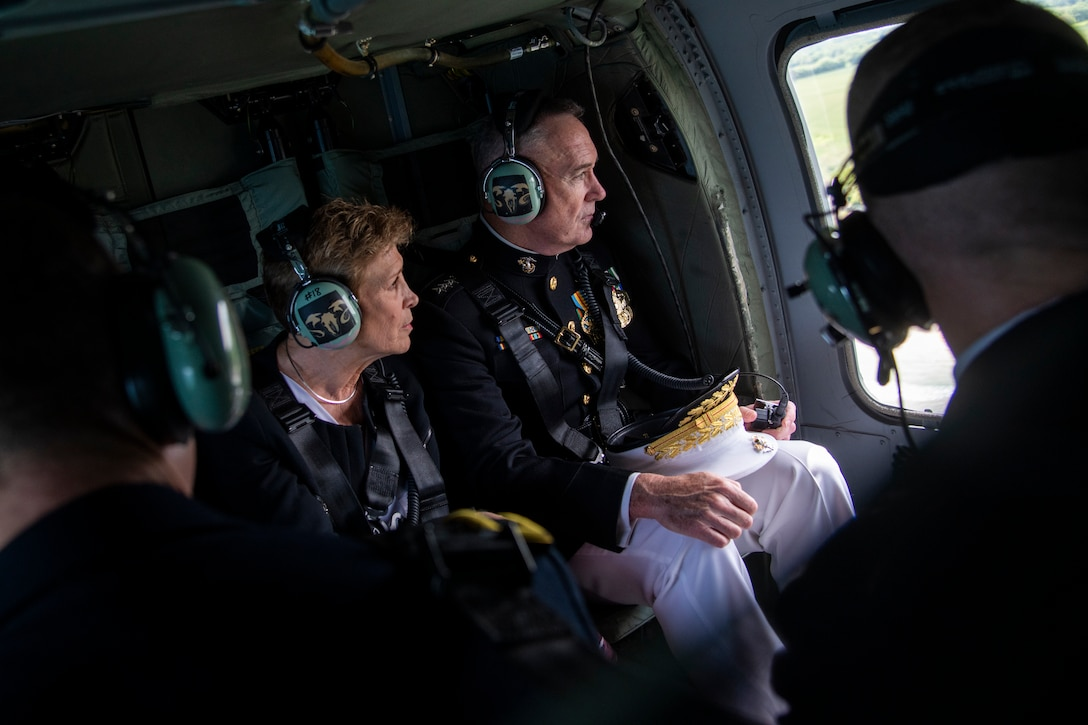 Marine Corps general and wife look out window of helicopter