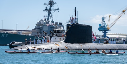 JOINT BASE PEARL HARBOR-HICKAM, Hawaii (June 6, 2019) – Members of the Outrigger Canoe Club escort the Virginia-class fast attack submarine USS Hawaii (SSN 776) as it arrives at Joint Base Pearl Harbor-Hickam, after completing its latest deployment, June 6. (U.S. Navy Photo by Mass Communication Specialist 1st Class Daniel Hinton)