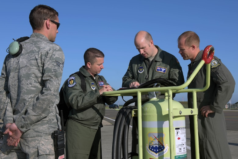 Airmen assigned to the 100th Air Refueling Wing, RAF Mildenhall, England, go over a pre-flight checklist prior to a refueling mission in support of the 75th anniversary commemoration of D-Day, at RAF Mildenhall, June 6, 2019. As seen during World War II, no nation can confront combat operations alone – and U.S. European Command with its subordinate components remain engaged, postured and ready to respond to threats as they arise. (U.S. Air Force photo by Senior Airman Benjamin Cooper)