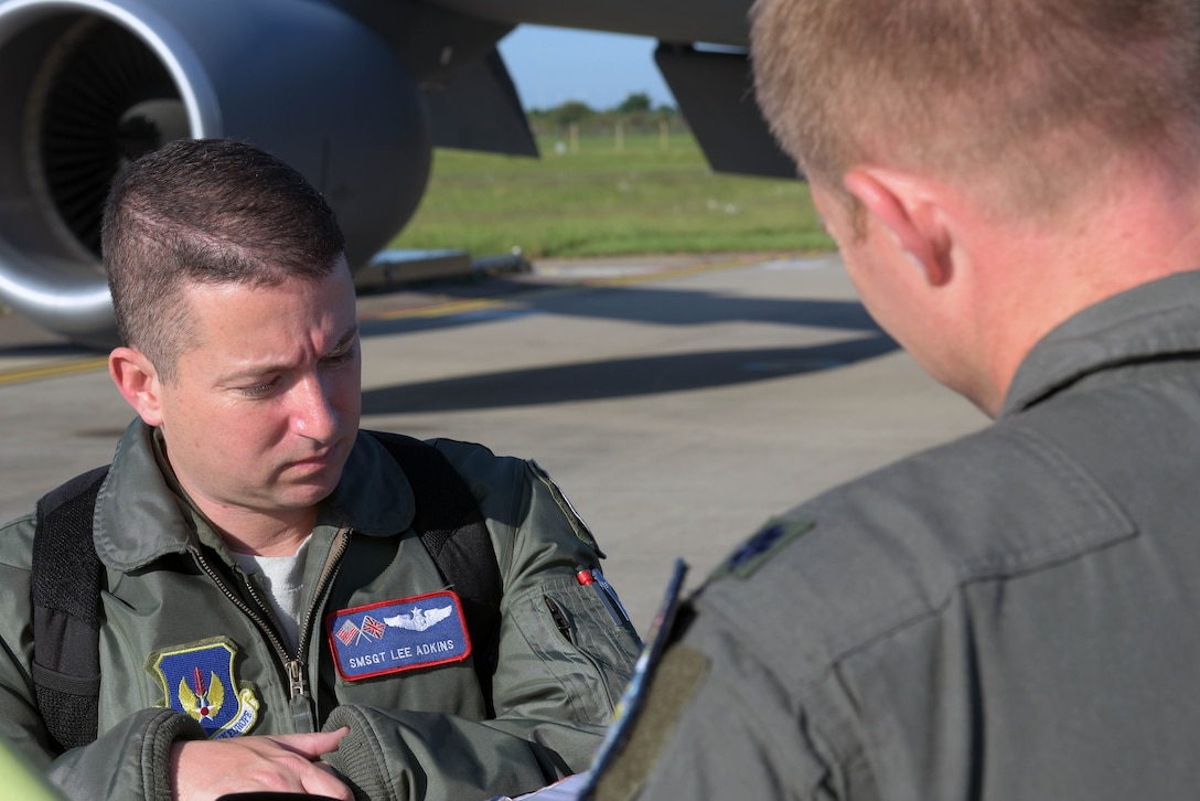 U.S. Air Force Senior Master Sgt. Lee Adkins, 100th Operations Group plans and exercises, looks over the pre-flight checklist prior to a refueling mission in support of the 75th anniversary commemoration of D-Day, at RAF Mildenhall, England, June 6, 2019. An epic multinational operation, D-Day forged partnerships and reinforced trans-Atlantic bonds that remain to this day. (U.S. Air Force photo by Senior Airman Benjamin Cooper)