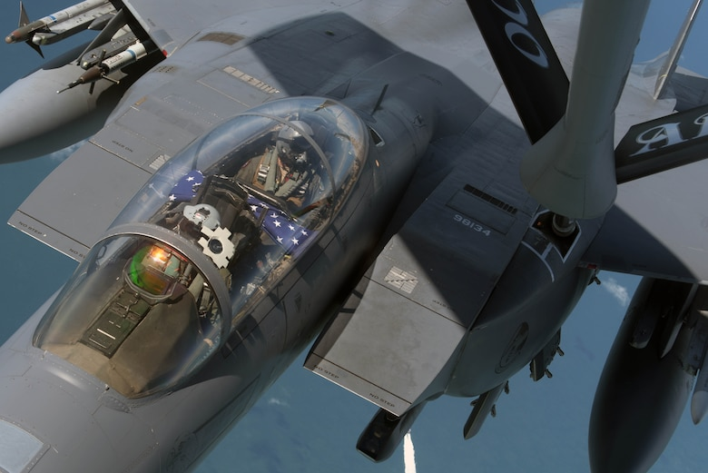 A U.S. Air Force F-15E Strike Eagle, assigned to the 492nd Fighter Squadron  at RAF Lakenheath, England, receives fuel from a U.S. Air Force KC-135 Stratotanker off the Southern coast of England, June 6, 2019. The Strike Eagle received fuel before taking part in a flight to commemorate the 75th anniversary of D-Day over France. Highlighting the strength of the U.S. commitment to European security, U.S. Air Force aircraft and other allied forces performed commemorative airborne operations across the European theater in support of the 75th anniversary of D-Day. (U.S. Air Force photo by Senior Airman Benjamin Cooper)