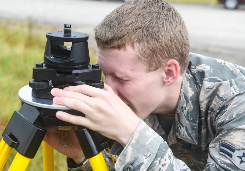 Airman 1st Class Weston Foust, an engineering assistant from the 20th Civil Engineer Squadron at Shaw Air Force Base, S.C., ensures a tripod is level while setting up global positioning receivers, June 5, 2019 at North Auxiliary Airfield, S.C. during an aircraft crash analysis exercise. Joint Base Charleston engineering assistants were joined by their counterparts from Shaw Air Force Base to help younger Airmen learn what it's like to coordinate with other bases during a real world crisis scenario. Engineering assistants specialize in planning and managing construction projects for military installations and ensuring that facilities and structures are able to operate at full capacity.