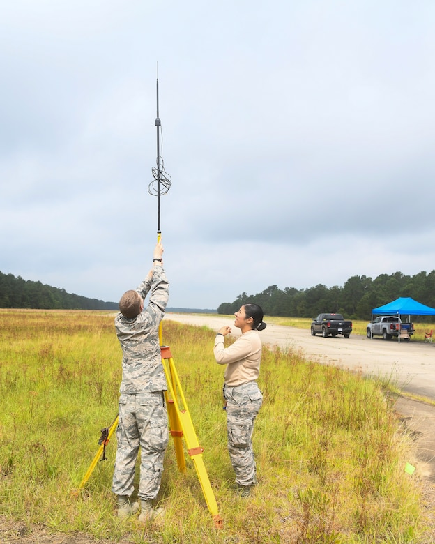 Airmen 1st Class Weston Foust and Krystal Figueroa, engineering assistants from the 20th Civil Engineer Squadron at Shaw Air Force Base, S.C., set up a global positioning device, June 5, 2019 at North Auxiliary Airfield, S.C., during an aircraft crash analysis exercise. The exercise allowed for Airmen to enhance their readiness and job knowledge by simulating an on-scene aircraft crash with real world requirements and standards. Air Force engineering assistants have the role of plotting out the positions of all debris pieces using global positioning devices during crash analysis operations. Engineering assistants specialize in planning and managing construction projects for military bases and ensuring that facilities and structures are able to operate at full capacity.