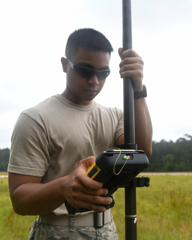 Airman 1st Class Jake Roxas, an engineering assistant assigned to the 628th Civil Engineer Squadron, uses a Trimble R8 Rover to plot the position of simulated aircraft wreckage, June 5, 2019 at North Auxiliary Airfield, S.C., during a crash assessment exercise. The exercise provided Airmen with the opportunity to practice on-seen protocols and to coordinate with other Airmen from Shaw Air Force Base, S.C., to completely map out debris in a simulated aircraft mishap. Air Force engineering assistants have the role of plotting out the positions of all debris pieces using global positioning devices during crash analysis operations. Engineering assistants specialize in planning and managing construction projects for bases and ensuring that facilities and structures are able to operate at full capacity.