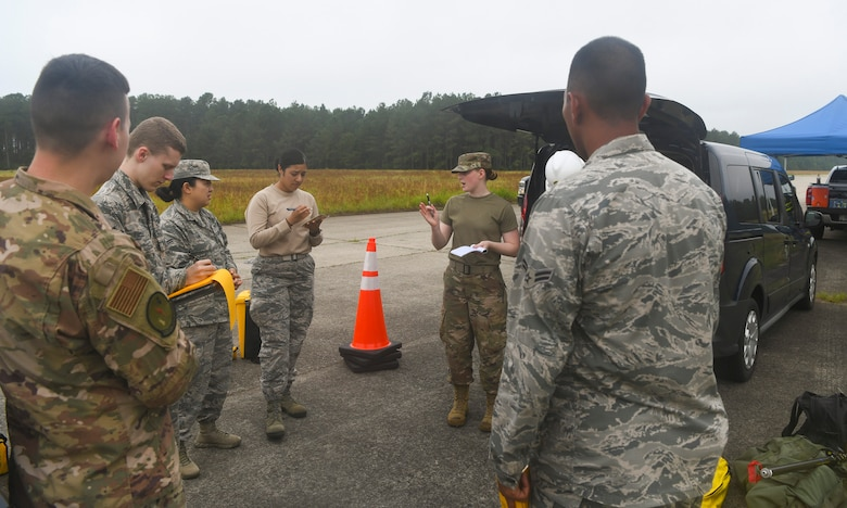 Engineering assistants from the 628th Civil Engineer Squadron out of Joint Base Charleston, S.C. and the 20th CES out of Shaw Air Force Base, S.C., discuss their mission plan during an aircraft crash analysis exercise June 5, 2019, at North Auxiliary Airfield, S.C. The exercise allowed Airmen to enhance their readiness and job knowledge by simulating an on-scene aircraft crash with real world requirements and standards. Air Force engineering assistants have the role of plotting out the positions of all debris pieces using global positioning devices during crash analysis operations. Engineering assistants specialize in planning and managing construction projects for military installations and ensuring that facilities and structures are able to operate at full capacity.