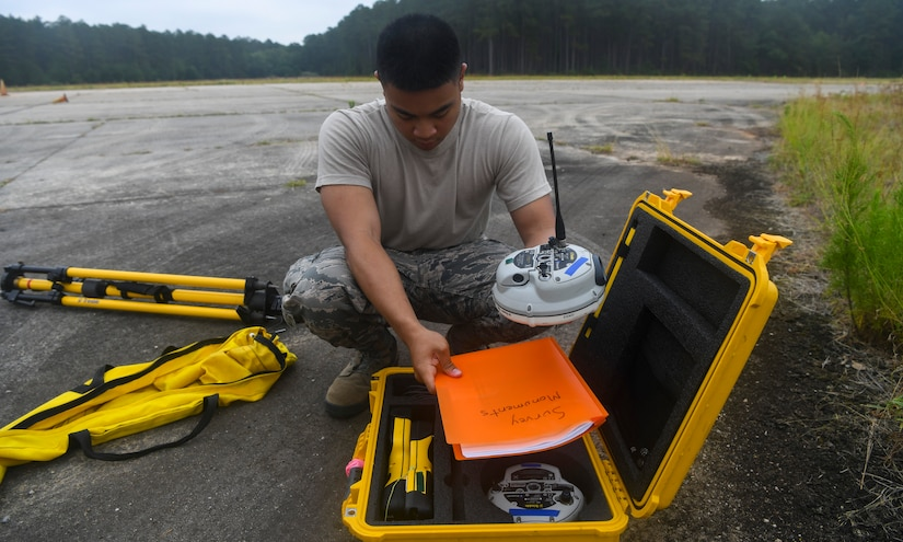Airman 1st Class Jake Roxas, an engineering assistant assigned to the 628th Civil Engineer Squadron, sets up a global positioning device during a crash assessment exercise June 5, 2019 at North Auxiliary Airfield, S.C. The exercise provided participants the opportunity to practice on-seen protocols and to coordinate with other Airmen from Shaw Air Force Base, S.C. to completely map out debris in a simulated aircraft mishap. Air Force engineering assistants have the role of plotting out the positions of all debris pieces using global positioning devices during crash analysis operations. Engineering assistants specialize in planning and managing construction projects for military installations and ensuring that facilities and structures are able to operate at full capacity. (U.S. Air Force photo by Senior Airman Cody R. Miller)