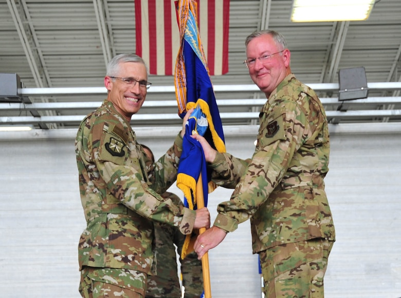 Maj. Gen. Craig L. LaFave, 22nd Air Force commander, passes the 403rd guidon to Col. Jeffrey A. Van Dootingh, during the 403rd Wing change of command ceremony June 9, 2019 at Keesler Air Force Base, Mississippi. (U.S. Air Force photo by Tech. Sgt. Michael Farrar)