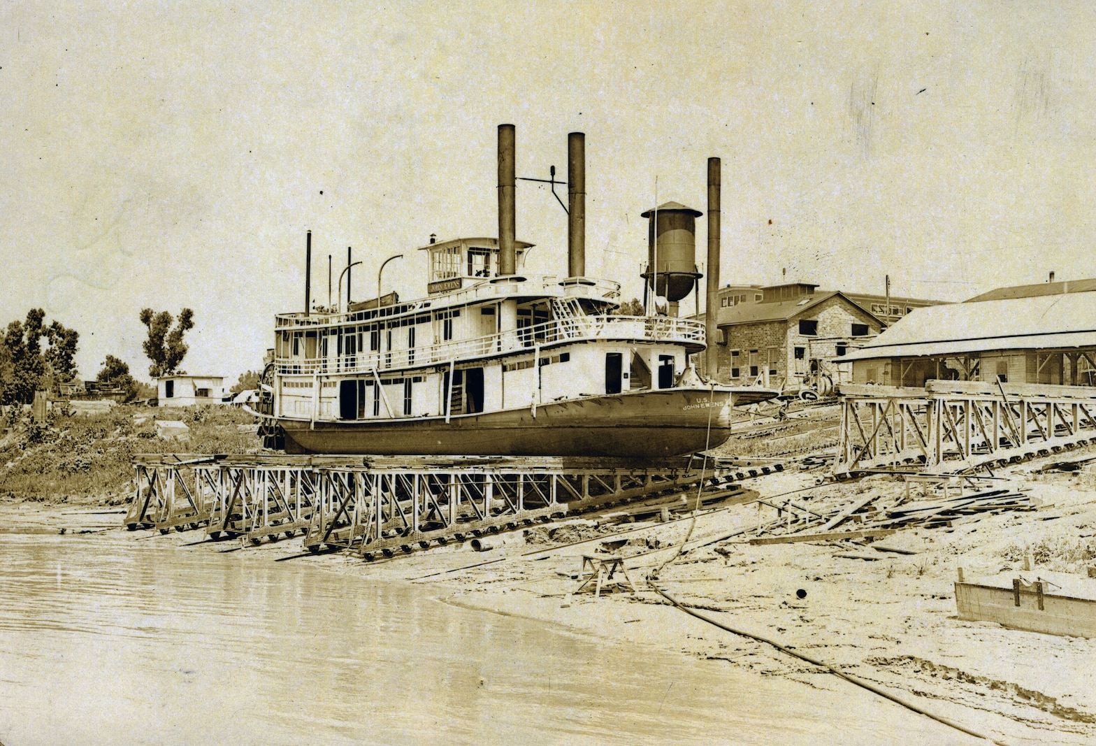 steamer on stilts on river shore