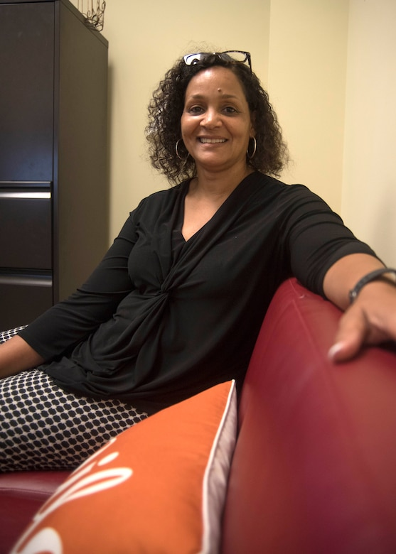 Brenda Edmond, 315th Airlift Wing Director of Psychological Health at Joint Base Charleston, invites guests to have a seat on her red couch, June 5, 2019, at her JB Charleston office in the Reserve Medical building. Edmond assumed the position of Director of Psychological Health in April 2019, after nearly 30 years of social work and mental health experience. (U.S. Air Force photo/Staff Sgt. Della S. Creech)