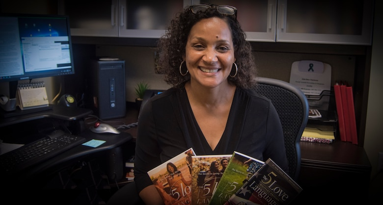Brenda Edmond, 315th Airlift Wing Director of Psychological Health at Joint Base Charleston, displays her favorite books to recommend, June 5, 2019, at her JB Charleston office in the Reserve Medical building. Edmond assumed the position of Director of Psychological Health in April 2019, after nearly 30 years of social work and mental health experience. (U.S. Air Force photo/Staff Sgt. Della S. Creech)