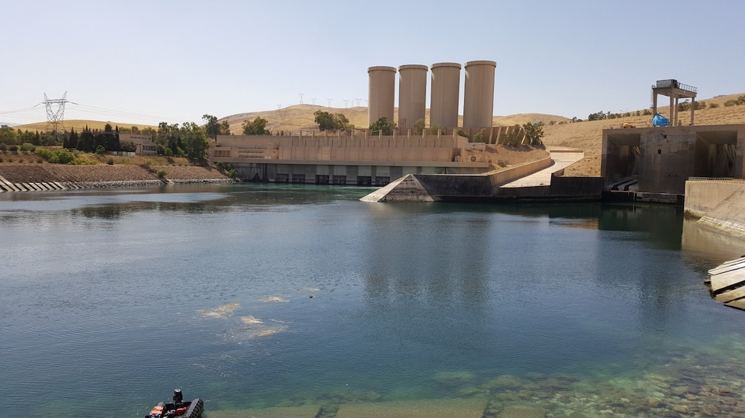 The Mosul Dam hydropower plant and its water storage towers, along with the West and East Bottom Outlet Tunnels at the Mosul Dam in 2018. The dam sits in a valley along the Tigris River approximately 30 miles outside Mosul City in Iraq. It is the largest dam in Iraq, and the fourth largest in the Middle East, and supplies water, hydropower, irrigation and flood control to the region.  The Mosul Dam Project was a 3-year partnership started in 2016 as a joint venture among the Iraq Ministry of Water Resources, the U.S. Army Corps of Engineers, and Italian Company Trevi S.p.A. in an effort to stabilize and repair the dam, and update the infrastructure of the dam.