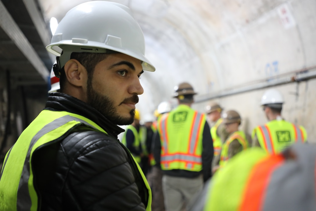 Iraq Computer Engineer Abdulrahman Alnuiami inside the grout tunnel at Mosul Dam. Alnuiami monitors the Automated Data Acquisition System that permits remote 24/7 instrumentation monitoring of the dam, using more than 800 devices installed onsite that gage water elevations, ground water pressures, water quality and flow rates, and surface displacement.
