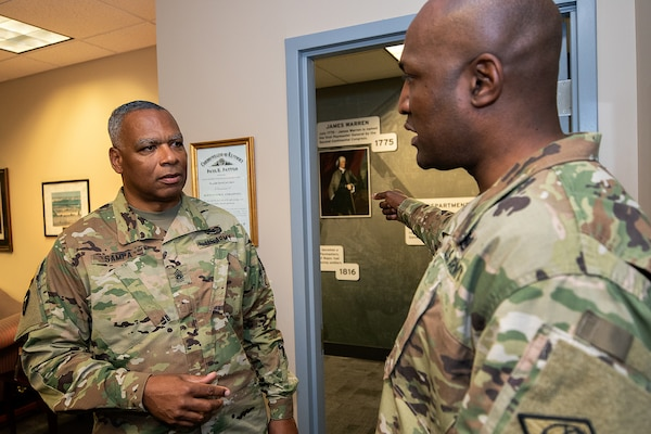 Command Sgt. Maj. John Sampa, 12th Command Sergeant Major of the Army National Guard, left, and Command Sgt. Maj. Courtney Ross, U.S. Army Financial Management Command command sergeant major have a discussion at the Maj. Gen. Emmett J. Bean Federal Center in Indianapolis June 6, 2019. During his visit, Sampa also met with Maj. Gen. David C. Coburn, USAFMCOM commanding general, and William Staley, USAFMCOM deputy to the commanding general, to discuss building stronger partnerships between Regular Army and National Guard financial management Soldiers. (U.S. Army photo by Mark R. W. Orders-Woempner)