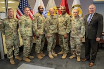Command Sgt. Maj. John Sampa, 12th Command Sergeant Major of the Army National Guard, center right, poses for a group photo during his visit to the U.S. Army Financial Management Command headquarters at the Maj. Gen. Emmett J. Bean Federal Center in Indianapolis June 6, 2019. During his visit, Sampa met with Maj. Gen. David C. Coburn, USAFMCOM commanding general, center; William Staley, USAFMCOM deputy to the commanding general, far right; and Command Sgt. Maj. Courtney Ross, USAFMCOM command sergeant major, center left, to discuss building stronger partnerships between Regular Army and National Guard financial management Soldiers. (U.S. Army photo by Mark R. W. Orders-Woempner)