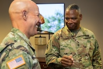 Command Sgt. Maj. John Sampa, 12th Command Sergeant Major of the Army National Guard, right, and Maj. Gen. David C. Coburn, U.S. Army Financial Management Command commanding general, share a moment at the Maj. Gen. Emmett J. Bean Federal Center in Indianapolis June 6, 2019. During his visit, Sampa also met with Command Sgt. Maj. Courtney Ross, USAFMCOM command sergeant major and William Staley, USAFMCOM deputy to the commanding general, to discuss building stronger partnerships between Regular Army and National Guard financial management Soldiers. (U.S. Army photo by Mark R. W. Orders-Woempner)