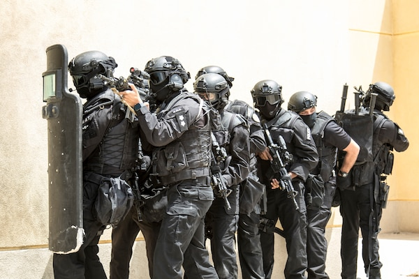 Members of the Kuwait Ministry of Interior's Special Weapons and Tactics team prepare to breach a building while pulling security on May 2, 2019, during a joint exercise with a simulated terrorist, explosive ordnance, and chemical situation at the Kuwait Special Forces Training Center. The exercise was crafted to build a shared understanding of Kuwait Civil Authorities and U.S. forces procedures while reacting to any disaster, natural and manmade alike.