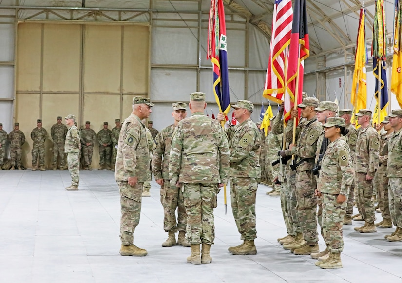 3rd Armored Brigade Combat Team, 4th Infantry Division Command Sgt. Maj. Brian D. Haydt prepares to pass the brigade colors to outgoing commander Col. Michael J. Simmering one last time as a symbol of the passing of leadership during a change of command ceremony at Camp Buehring, Kuwait on Saturday, June 8, 2019. Simmering relinquished command to incoming commander Col. Grant S. Fawcett.