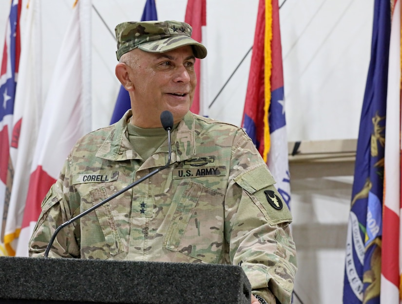 Maj. Gen. Benjamin Correll, commander of the 34th Infantry Division, which leads Task Force Spartan, congratulates both the outgoing commander of the 3rd Armored Brigade Combat Team, 4th Infantry Division, Col. Michael J. Simmering, and the incoming commander, Col. Grant S. Fawcett, during a change of command ceremony at Camp Buehring, Kuwait on Saturday, June 8, 2019. During his remarks, Correll praised Simmering's leadership during the brigade's support of Operation Spartan Shield, and challenged Fawcett to maintain a standard of excellence as he took command.