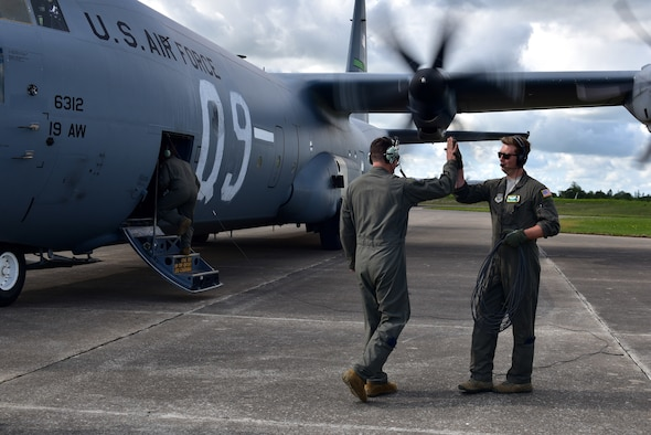 An Airman inspects the prop of a C-130J