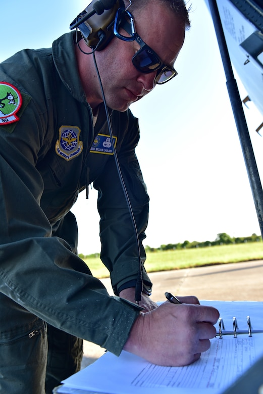 An Airman signs off a checklist