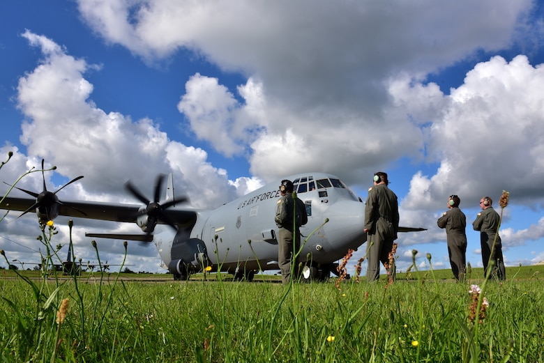 Airmen hstand around a C-130J