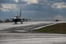 Danish F-16s taxi down the runway after landing during Arctic Challenge Exercise 19, a multinational training exercise with participation of U.S. Marines from Marine Fighter Attack Squadron 251, at Rovaniemi Air Base, Finland, May 28, 2019. The U.S. Marine Corps' participation in Arctic Challenge 19 ensures interoperability and enables the Marine Corps to globally deploy its forces alongside partner nations and allies. (U.S. Marine Corps photo by 1st Lt. Christin St. John)