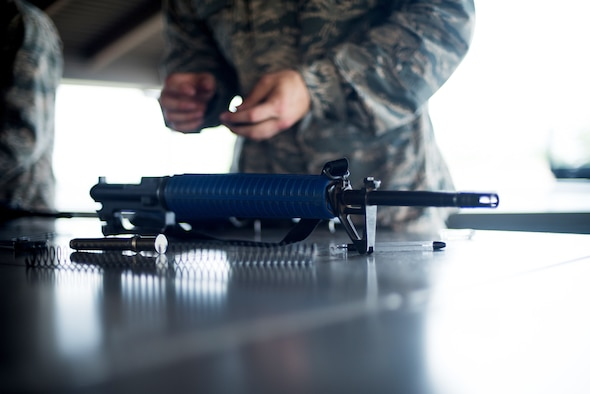 U.S. Air Force basic military training trainees practice assembling and disassembling their M-16 trainer weapon, May 2, 2019, at Joint Base San Antonio-Lackland. Starting this summer the M16 rifle will be phased out for the M4, BMT is set to receive close to 9,000 M4 training rifles. (U.S. Air Force photo by Sarayuth Pinthong)
