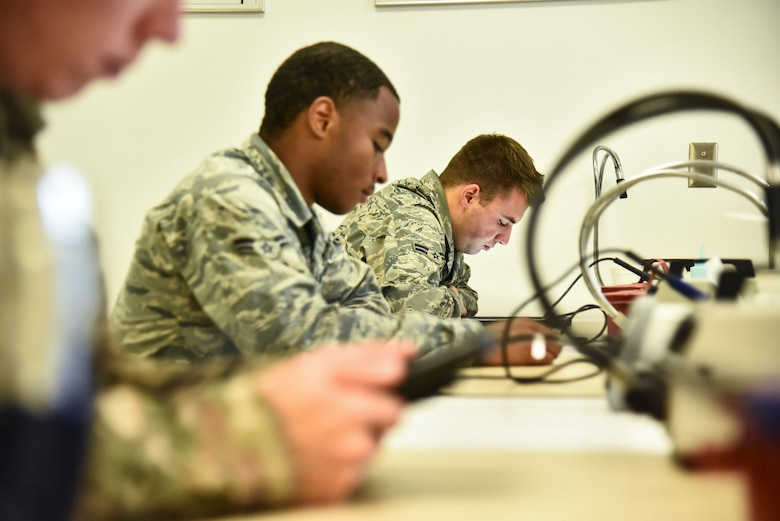 Students assigned to the 372d Training Squadron, Detachment 11, attend an advanced wire maintenance course at Davis-Monthan Air Force Base, Ariz., June 4, 2019. The 372d TRS, Det. 11, is a unit specifically dedicated to improving maintenance Airmen skills surrounding the many lethal aircraft assigned to the 355th Wing at D-M. (U.S. Air Force photo by Senior Airman Mya M. Crosby)