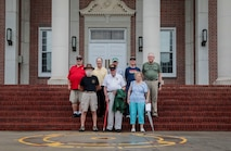 Marine Corps veterans and members of the Marine Corps league gather for a group photo at the steps of the general's building on Marine Corps Recruit Depot Parris Island, S.C. June 7, 2019. The Marines gathered to commemorate 64 years of graduating recruit training.