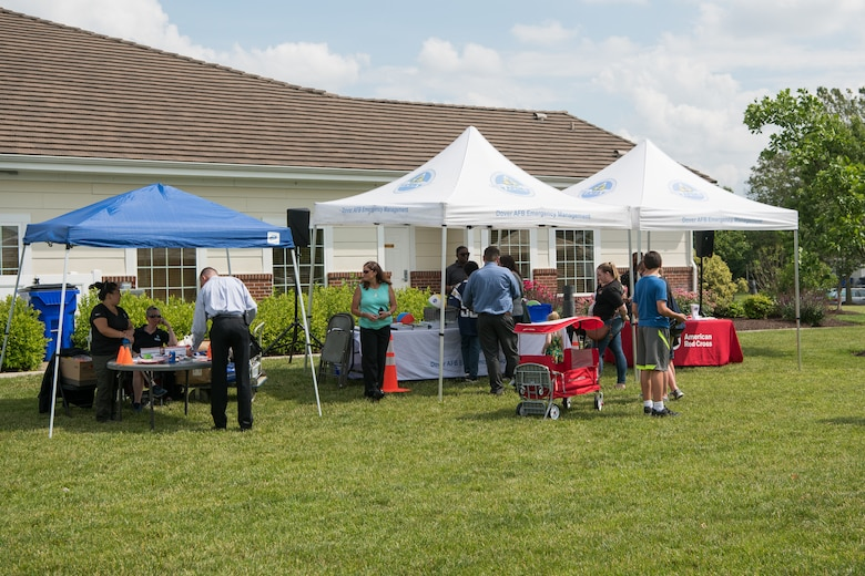 Attendees enjoy the Hurricane Block Party June 6, 2019, at the Eagle Heights family housing on Dover Air Force Base, Del. The annual event is co-hosted by the 436th Civil Engineer Squadron and the Eagle Heights housing office. (U.S. Air Force Photo by Mauricio Campino)