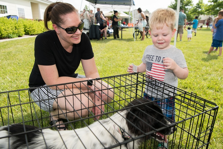 Hudson McCormick meets Petunia at the Hurricane Block Party June 6, 2019, at the Eagle Heights family housing on Dover Air Force Base, Del. Petunia was one of several dogs brought out by the First State Animal Shelter and Society for the Prevention of Cruelty to Animals of Camden to, hopefully, find a home with one of the families in attendance. (U.S. Air Force Photo by Mauricio Campino)