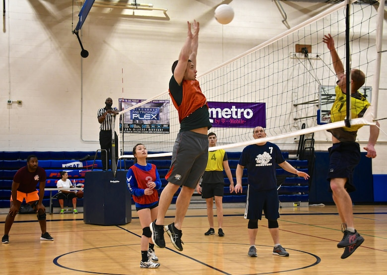 Staff Sgt. Tyler Hambidge, 932nd Medical Squadron, blocks the volleyball back over the net during recent intramural competition at Scott Air Force Base, Ill.  The 932nd Airlift Wing has volunteers participating in a variety of  sports throughout the year, to include volleyball and summer softball.  (U.S. Air Force photo by Lt. Col. Stan Paregien)