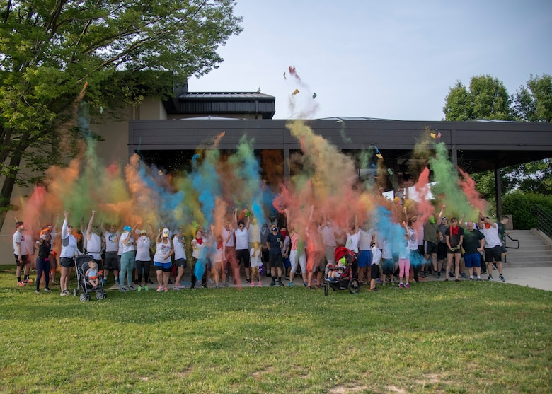 Participants of the Sexual Assault Awareness Month Color Run kick off the event by throwing color powder into the air June 5, 2019, at Dover Air Force Base, Del. The annual run is hosted by the Dover AFB Sexual Assault Prevention and Response team.  (U.S. Air Force photo by Staff Sgt. Esteban Esquivel)