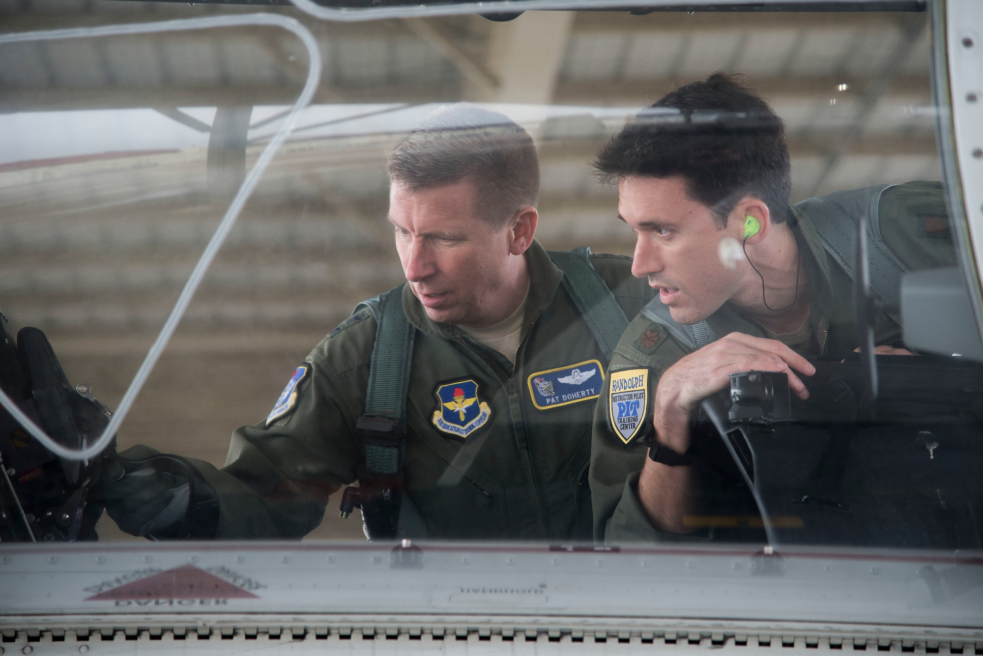 U.S. Air Force Maj. Gen. Patrick Doherty, 19th Air Force commander, and Maj. Lincoln Olsen, T-6 instructor pilot, conduct a T-6 Texan II safety check before conducting an operational demonstration at Joint Base San Antonio-Randolph, Texas, Feb. 21, 2018. Doherty was on the flight line getting test data first-hand during the command-wide T-6 operational pause. (U.S. Air Force photo by Sean Worrell)