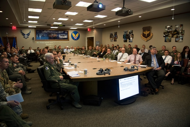 Attendees from both in and outside the Department of Defense listen to a briefing on the T-6 On-Board Oxygen Generating Systems during a conference at Joint Base San Antonio-Randolph, Texas, May 29-30, 2019. During the conference, machine and human aspects of the problem were discussed, as well as the human-machine interface as part of the on-going effort to improve the safety of the OBOGS. (U.S. Air Force photo/Senior Airman Story Archer)
