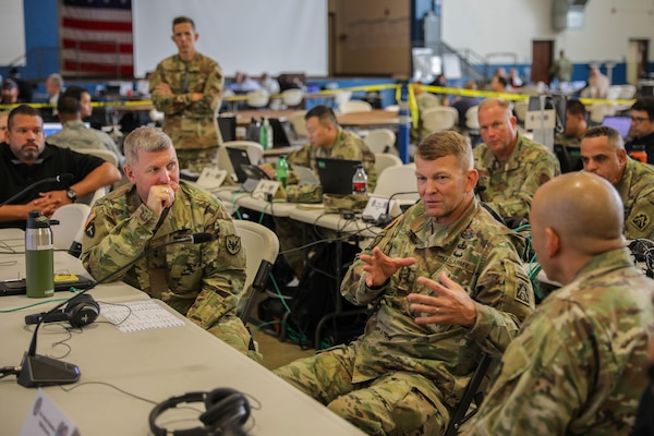 "Commander, US Army North (ARNORTH) Lt. Gen. Jeffrey Buchanan speaks with Commander, Joint Task Force Civil Support (JTF-CS) Maj. Gen. William ""Bill"" Hall (left), and JTF-CS Director of Operations Col. Eric Oh during a ten minute drill as part of Ardent Sentry 2019. The ARNORTH-led exercise was conducted in support of FEMA's exercise Shaken Fury, which simulated a catastrophic earthquake along the New Madrid Seismic Zone (NMSZ) near Memphis, Tennessee that affected eight states. Exercise Shaken Fury tested the national incident management system. During the exercise, which ran from May 29 - June 5, nearly 100 JTF-CS personnel supported more than 50 command members who were forward-deployed to Nashville, Tenn.; Berry Field, Tenn.; Jackson, Miss.; Jefferson City, Mo. and Ft. Sam Houston, Tx. in response to a notional 7.7 magnitude earthquake in the New Madrid Seismic Zone (NMSZ). Ardent Sentry is a U.S. Northern Command exercise geared toward building and strengthening interagency relationships by providing defense support of civil authorities during the NMSZ earthquake scenario. (Official DoD photo by Mass Communication Specialist 3rd Class Michael Redd/released)"