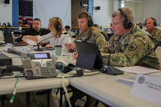 "From right, Commander, Joint Task Force Civil Support (JTF-CS) Maj. Gen. William ""Bill"" Hall, Commander, US Army North (ARNORTH) Lt. Gen. Jeffrey Buchanan and Regional Administrator for the Federal Emergency Management Agency (FEMA) Region IV Gracia Szczech participate in a Commander's Update Brief (CUB) during exercise Ardent Sentry 2019. The ARNORTH-led exercise was conducted in support of FEMA's exercise Shaken Fury, which simulated a catastrophic earthquake along the New Madrid Seismic Zone (NMSZ) near Memphis, Tennessee that affected eight states. Exercise Shaken Fury tested the national incident management system. During the exercise, which ran from May 29 - June 5, nearly 100 JTF-CS personnel supported more than 50 command members who were forward-deployed to Nashville, Tenn.; Berry Field, Tenn.; Jackson, Miss.; Jefferson City, Mo. and Ft. Sam Houston, Tx. in response to a notional 7.7 magnitude earthquake in the New Madrid Seismic Zone (NMSZ). Ardent Sentry is a U.S. Northern Command exercise geared toward building and strengthening interagency relationships by providing defense support of civil authorities during the NMSZ earthquake scenario. (Official DoD photo by Mass Communication Specialist 3rd Class Michael Redd/released)"