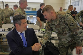 Commander, US Army North (ARNORTH) Lt. Gen. Jeffrey Buchanan greets Director of the Tennessee Emergency Management Agency Patrick Sheehan inside the joint operation center during exercise Ardent Sentry 2019. The ARNORTH-led exercise was conducted in support of FEMA's exercise Shaken Fury, which simulated a catastrophic earthquake along the New Madrid Seismic Zone (NMSZ) near Memphis, Tennessee that affected eight states. Exercise Shaken Fury tested the national incident management system. During the exercise, which ran from May 29 - June 5, nearly 100 JTF-CS personnel supported more than 50 command members who were forward-deployed to Nashville, Tenn.; Berry Field, Tenn.; Jackson, Miss.; Jefferson City, Mo. and Ft. Sam Houston, Tx. in response to a notional 7.7 magnitude earthquake in the New Madrid Seismic Zone (NMSZ). Ardent Sentry is a U.S. Northern Command exercise geared toward building and strengthening interagency relationships by providing defense support of civil authorities during the NMSZ earthquake scenario. (Official DoD photo by Mass Communication Specialist 3rd Class Michael Redd/released)