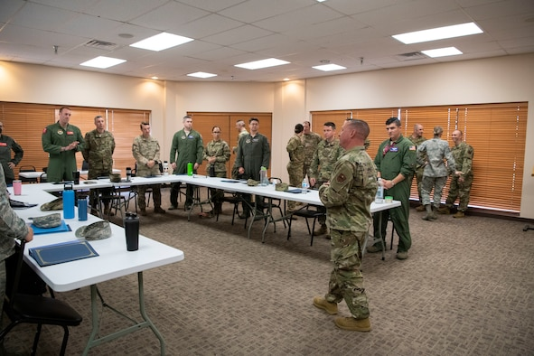 A First Sergeant talks to a group of noncommissioned officers.