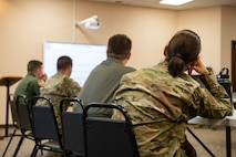 Noncommissioned officers watch a presentation on how to become a First Sergeant.