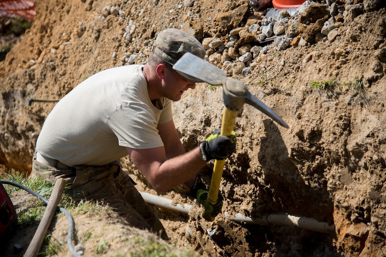 Snapshot: Dover dirt boys dig a trench > Dover Air Force
